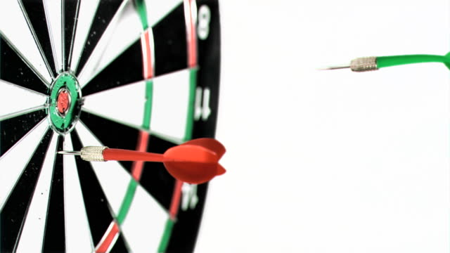 three darts being thrown in super slow motion on a dart board - dart board stock videos & royalty-free footage