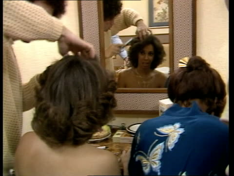 three degrees england london chelsea ms 2 of the three degrees preparing to go to the palace one has hair brushed cu one in mirror pull out hair... - buckingham palace stock videos & royalty-free footage