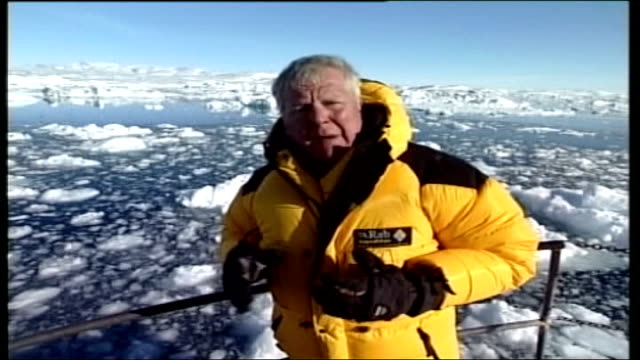 greenland greenland ext inuit men along on sleds pulled by husky dogs through the snow during annual race good shots mcginty watching from finishing... - inuit stock videos & royalty-free footage