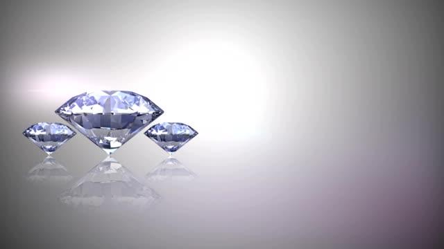 vídeos de stock, filmes e b-roll de três diamantes gira arco 3d - anel joia