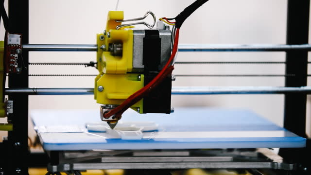 Three dimensional 3D printing machine in action