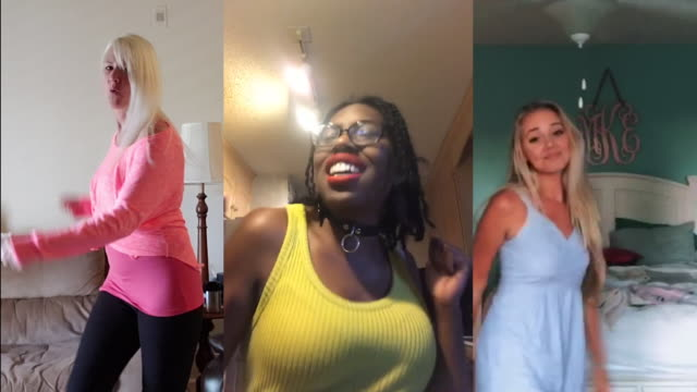 three diverse women dance and sing together while video chatting - tipo di danza video stock e b–roll