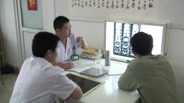 MS, Three doctors analyzing x-ray images, Shandong Jinan Baofa Cancer Hospital, Jinan, Shandong, China