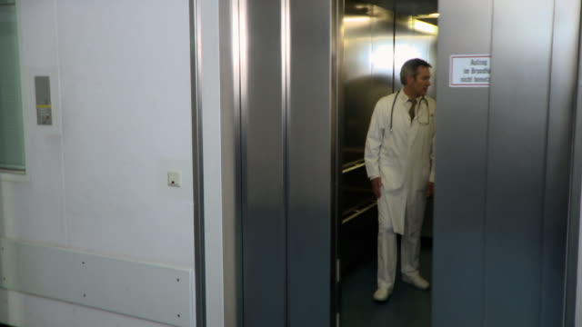 ms, three doctors exiting elevator in hospital, berlin, germany - leaving hospital stock videos & royalty-free footage