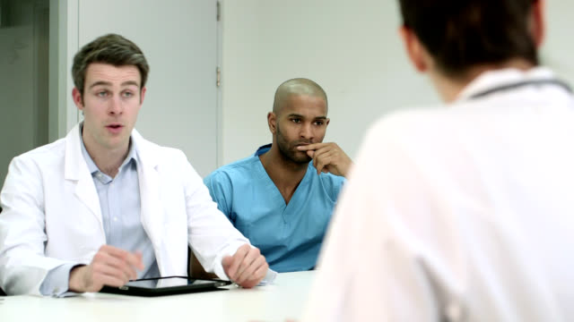 three doctors in meeting - completely bald stock videos & royalty-free footage