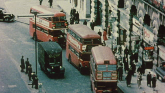 1956 ha three double decker buses pull over at a stop / london, england - doppeldeckerbus stock-videos und b-roll-filmmaterial
