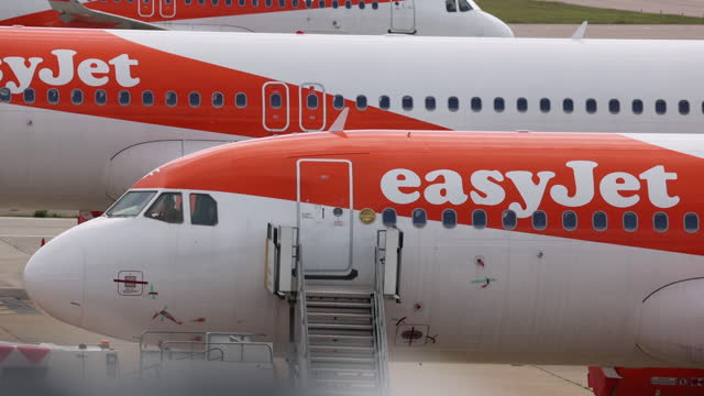 three easyjest airplanes at london luton airport, medium shot in london, england, uk, on monday, may 10, 2021. - luton airport stock videos & royalty-free footage