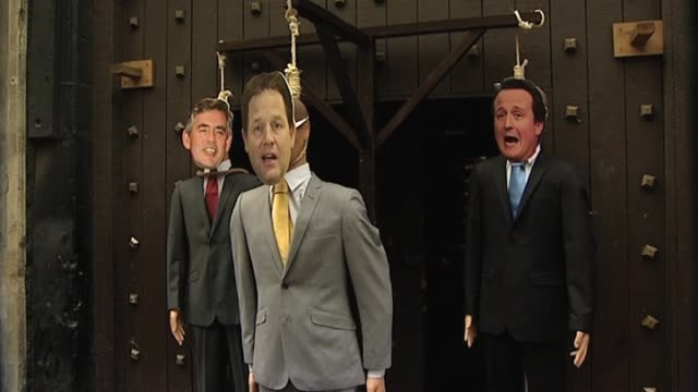 three effigies of the political leaders hang from ropes ahead of general election on may 6 london 28 april 2010 - effigy stock videos & royalty-free footage