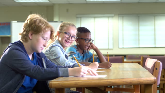 three elementary school students writing, talking - 10 11 years stock videos & royalty-free footage