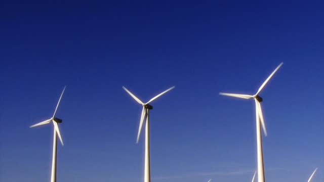 Three energy windmills turn in the California desert.