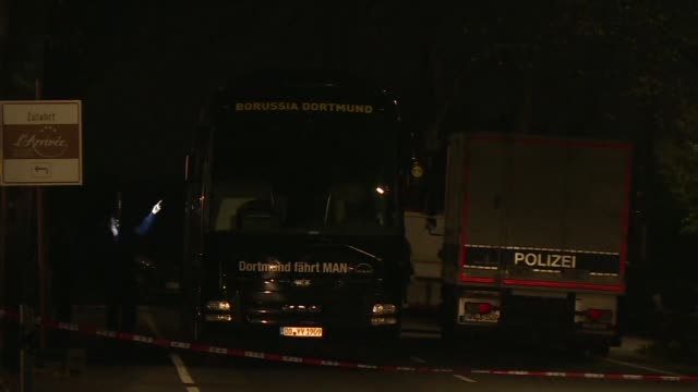 three explosions rock the borussia dortmund bus injuring spanish international marc bartra as the german team headed for a champions league game... - borussia dortmund stock videos and b-roll footage