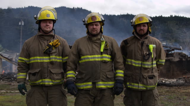 three firemen stand in front of the smoldering ruins of a house - myrtle creek stock videos & royalty-free footage