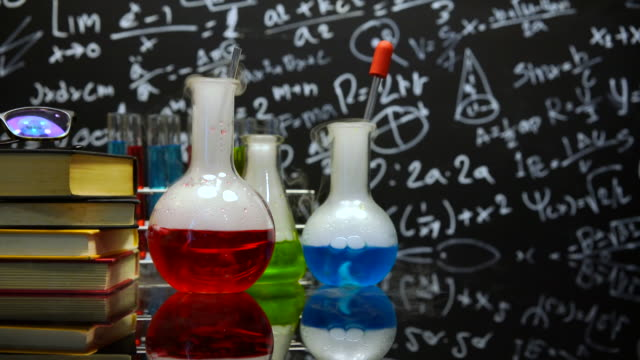 three flask of water black orange solution in science - laboratory flask stock videos & royalty-free footage