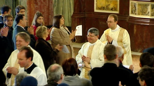 three former church of england bishops ordained as catholic priests; england: london: westminster cathedral: int **music heard sot** former anglican... - westminster cathedral stock videos & royalty-free footage