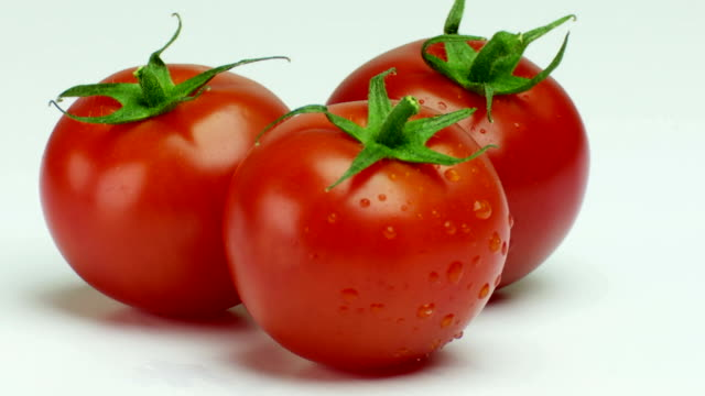 three fresh tomatoes turning close-up - frische stock videos & royalty-free footage