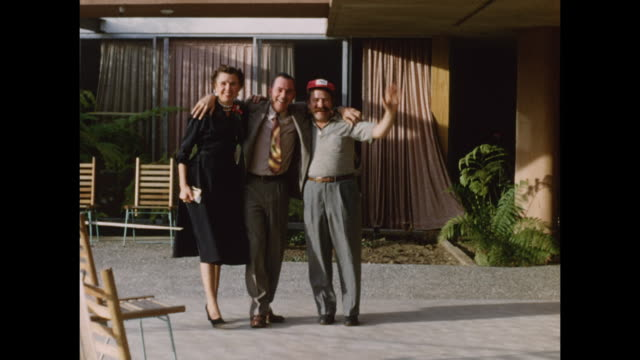 three friends dance into the camera smiling. - older woman fun stock-videos und b-roll-filmmaterial