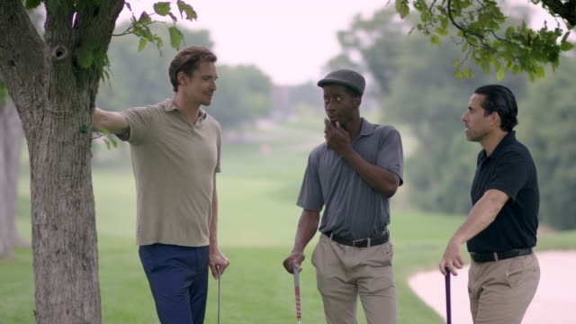 three friends golfing and talking - fatcamera stock videos & royalty-free footage