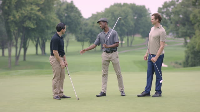 three friends golfing and talking - golf stock videos & royalty-free footage