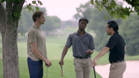 three friends golfing and talking - golfer stock videos & royalty-free footage