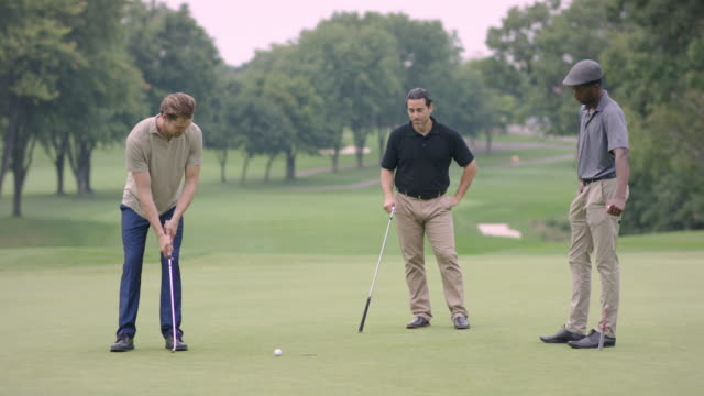 three friends golfing and talking - golf club stock videos & royalty-free footage