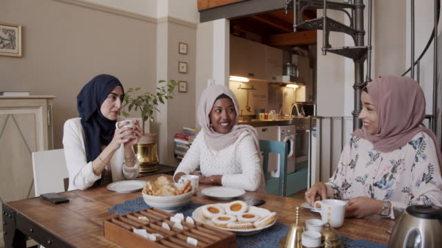 three friends having breakfast together at home - hijab stock videos & royalty-free footage
