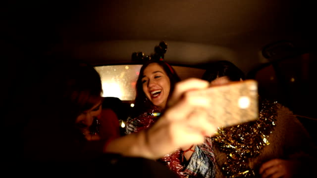 three friends having fun in taxi on their way to the party - dancing back to back stock videos & royalty-free footage