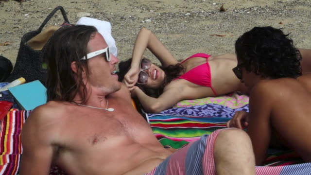 three friends sunbathing on beach - puerto rican ethnicity stock videos & royalty-free footage