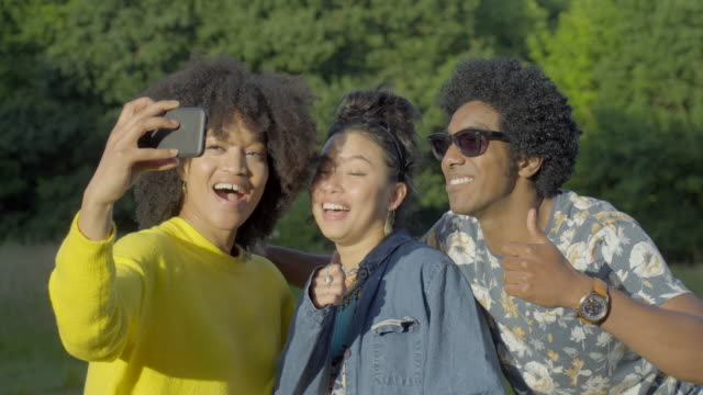 three friends take a selfie - bright stock videos & royalty-free footage