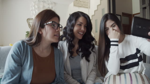 three friends taking a selfie together - female friendship stock videos & royalty-free footage
