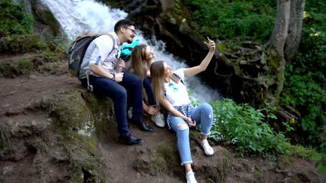 three friends taking selfie in forest - meraviglie della natura video stock e b–roll