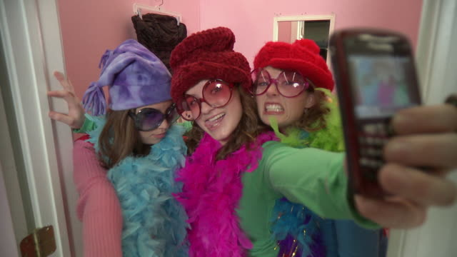 ms three friends wearing costumes and taking photo with mobile phone /  morris, illinois, usa - verkleidung kleidung stock-videos und b-roll-filmmaterial