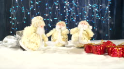 Three funny musicians Santa Claus with their gifts are having fun, dancing, celebrating and congratulating in the whirling snow and at the end the inscription Happy New Year.