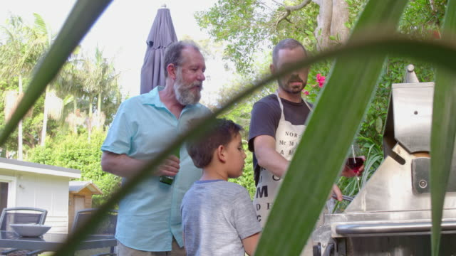 three generation australian family men cooking together prawns at barbecue - traditionally australian stock videos & royalty-free footage