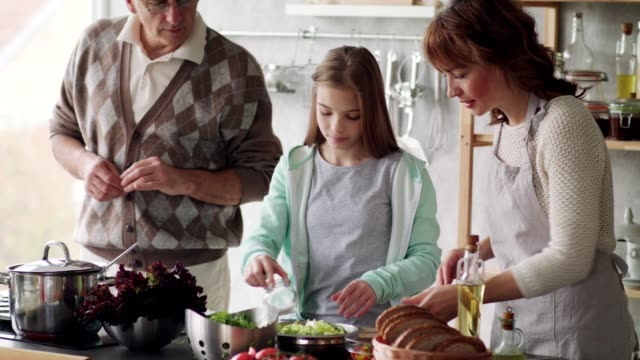 three generation family cooking together - togetherness stock videos & royalty-free footage