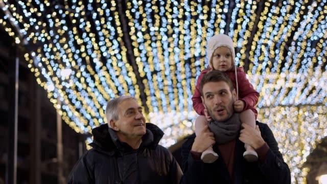 three generation family enjoying christmas - attività commerciale video stock e b–roll