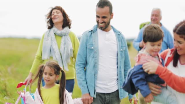 Three Generation Family On A Walk