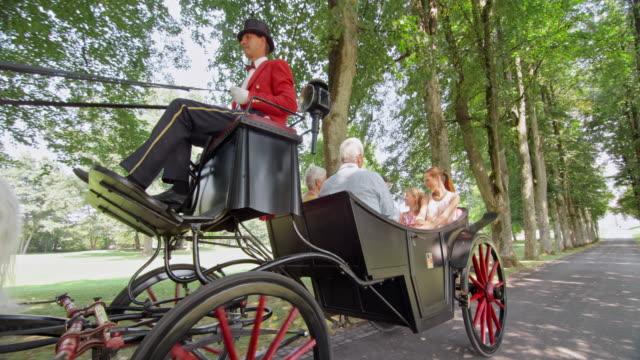 SLO MO TS Three generation family on horse carriage ride
