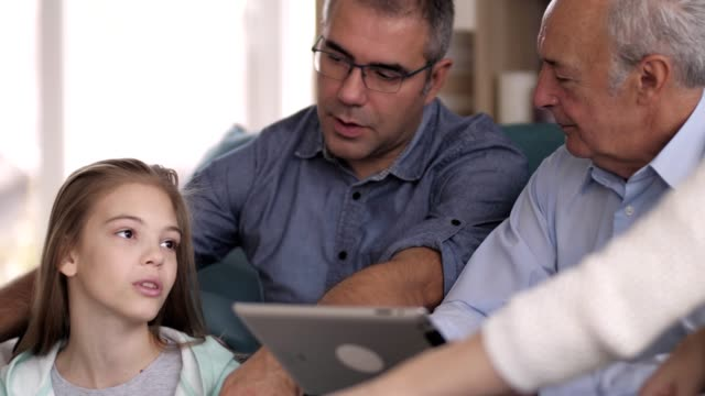 three generation family relaxing at home - granddaughter stock videos & royalty-free footage