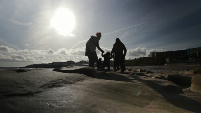three generation family walking on the beach - whitley bay stock videos & royalty-free footage