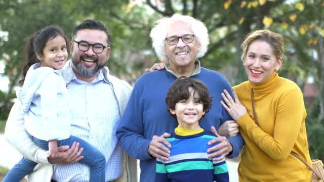 stockvideo's en b-roll-footage met drie generatie hispanic familie nemen wandelen in park - 35 39 years