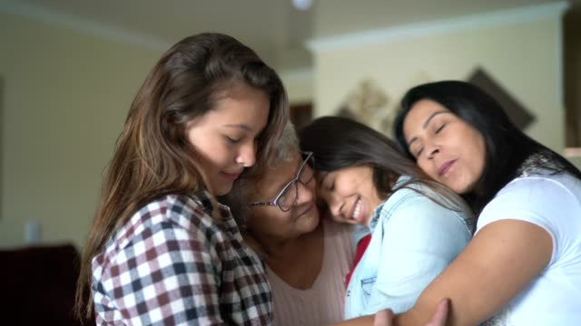 three generation women's family embracing - mixed age range stock videos & royalty-free footage
