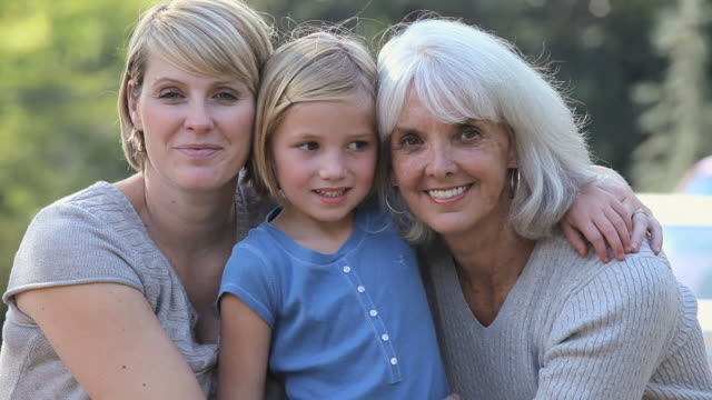 cu three generations family hugging outdoors/ richmond, virginia, usa. - großmutter stock-videos und b-roll-filmmaterial