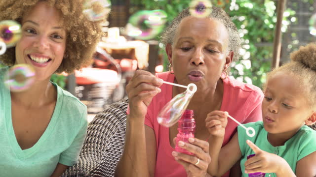 three generations of women blowing bubbles - bubble wand stock videos & royalty-free footage