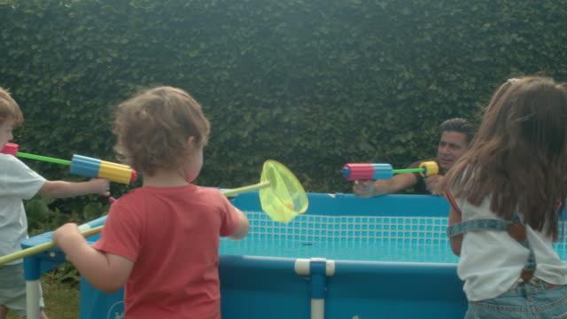 three generations - water pistol stock videos & royalty-free footage