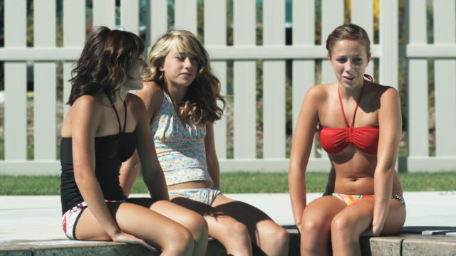 three girls by the pool getting splashed by a boy - 14 15 years stock videos and b-roll footage