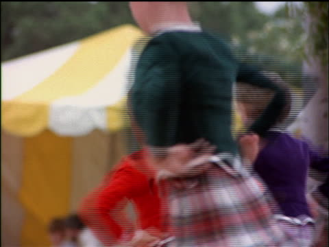 three girls dance the scottish sword dance at the highland games in los angeles. - highland games stock videos & royalty-free footage