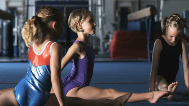 ms three girls (8-9) doing splits in gym, orem, utah, usa - orem utah stock videos & royalty-free footage