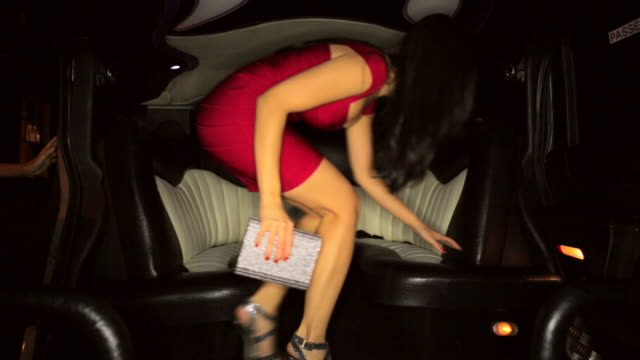 ws three girls enter and sit in limousine - beifahrersitz oder rücksitz stock-videos und b-roll-filmmaterial