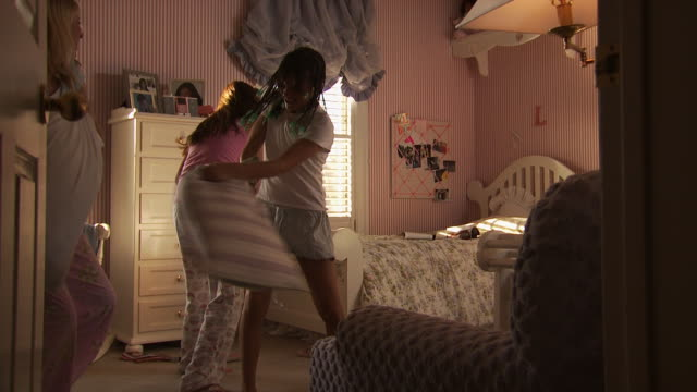 three girls having a pillow fight - slumber party stock videos and b-roll footage