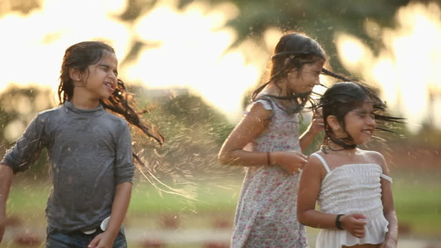 three girls playing in a park - wet hair stock videos & royalty-free footage